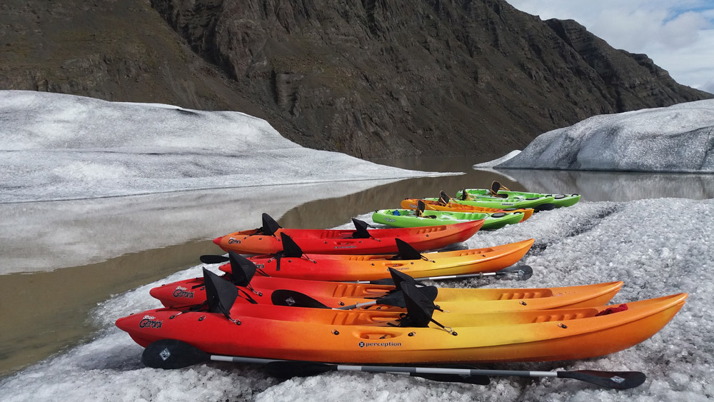 Kayaks on an iceberg